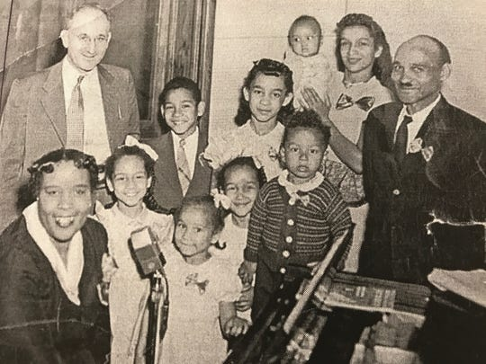"Martha Cunningham, back row, third from the left, grew up performing with her family in a gospel group known as the Happy Home Jubilee Singers. Cas Walker, back row, far left, featured the family on his ""Farm and Home Hour"" television show."