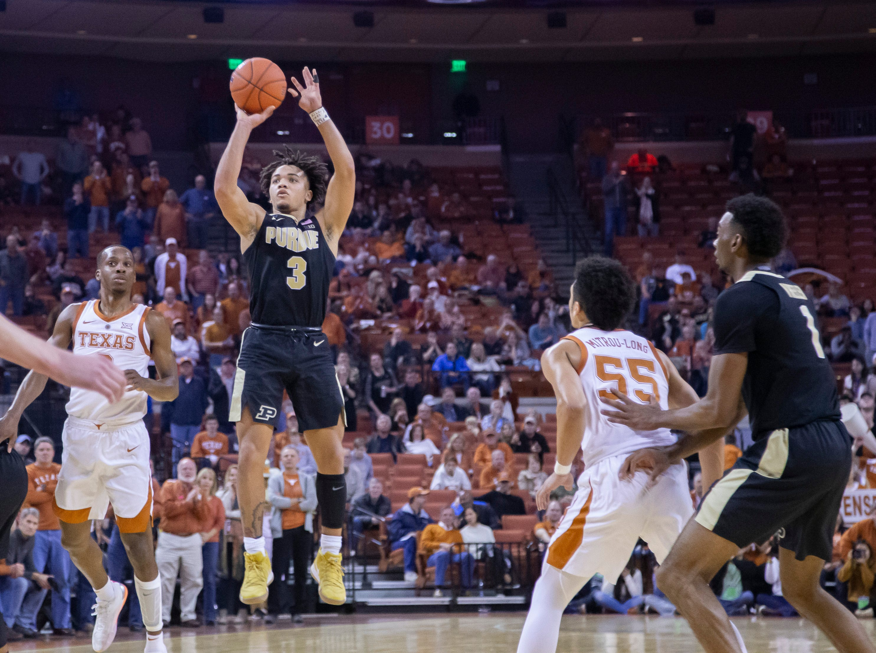 Dec 9, 2018; Austin, TX, USA; Purdue Boilermakers guard Carsen Edwards (3) goes for a long jump shot against the Texas Longhorns during the second half at Frank Erwin Center. Mandatory Credit: John Gutierrez-USA TODAY Sports