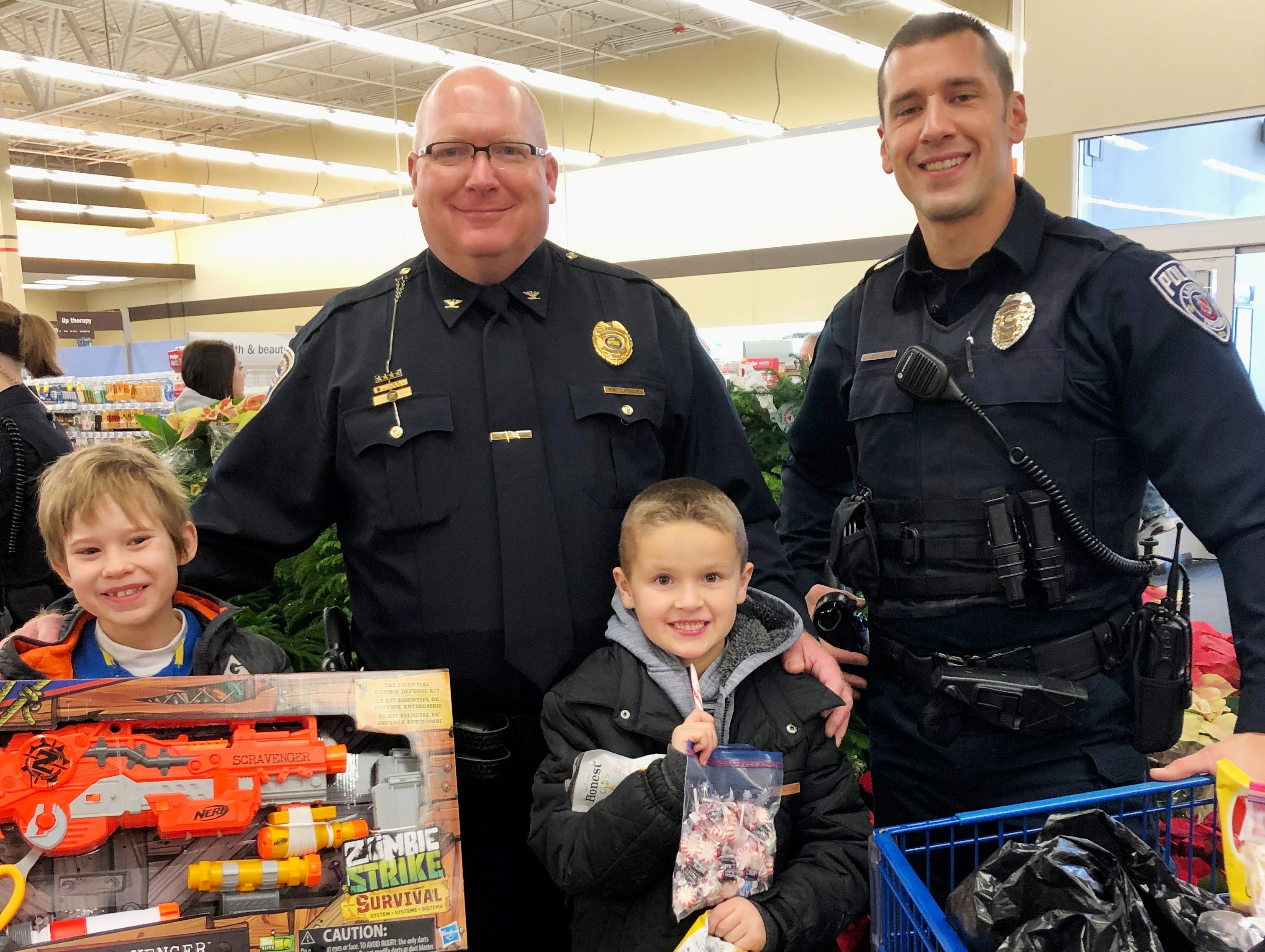 Area children take part in Shop With a Cop Saturday, December 8, in Lafayette. According to event co-coordinator Lindsey Martin, about 50 children ranging in age from infants to high school, paired up with officers from multiple local law enforcement agencies for the program. The event is hosted FOP Loge 49, which serves all of the officers in the Tippecanoe County area.
