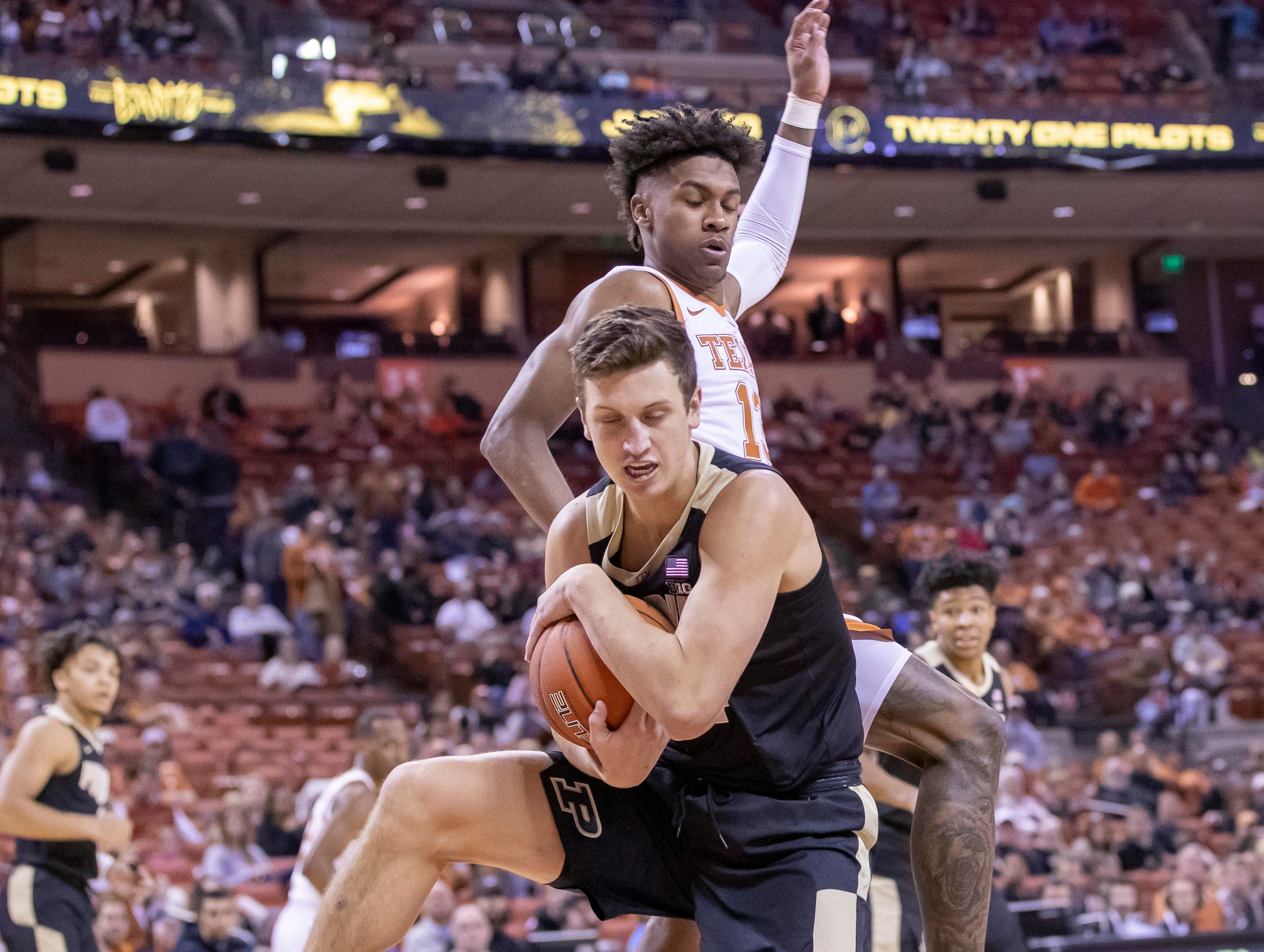 Dec 9, 2018; Austin, TX, USA; Purdue Boilermakers forward Grady Eifert (24) rebounds the ball against the Texas Longhorns at Frank Erwin Center. Mandatory Credit: John Gutierrez-USA TODAY Sports