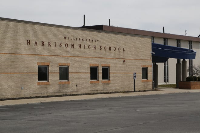 A Harrison High School student was arrested and released to his parent Thursday after suspected of coming to school under the influence of alcohol.