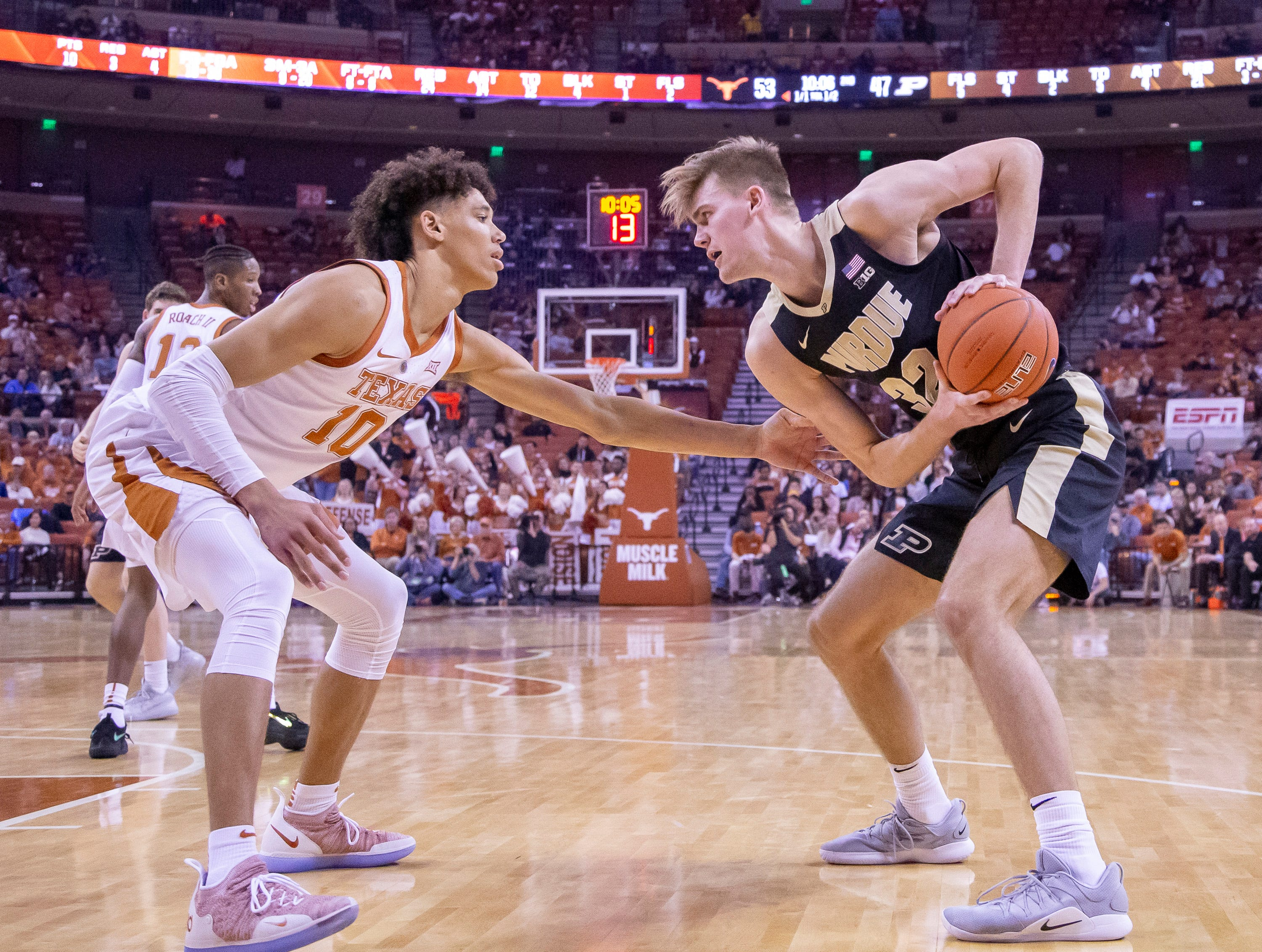 Dec 9, 2018; Austin, TX, USA; Texas Longhorns forward Jaxson Hayes (10) defends Purdue Boilermakers center Matt Haarms (32) during the second half at Frank Erwin Center. Mandatory Credit: John Gutierrez-USA TODAY Sports