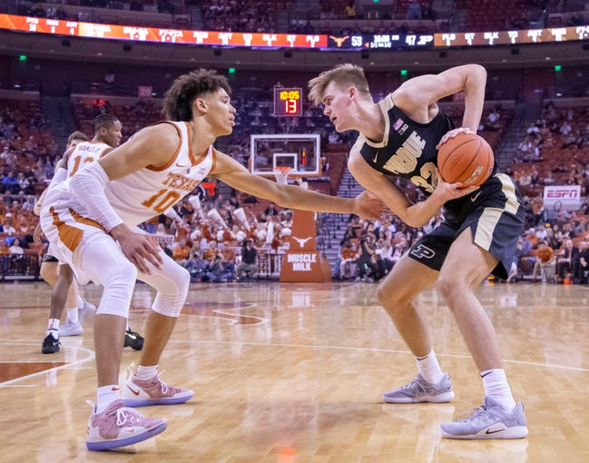 Dec 9, 2018; Austin, TX, USA; Texas Longhorns forward Jaxson Hayes (10) defends Purdue Boilermakers center Matt Haarms (32) during the second half at Frank Erwin Center. Mandatory Credit: John Gutierrez-USA TODAY Sports