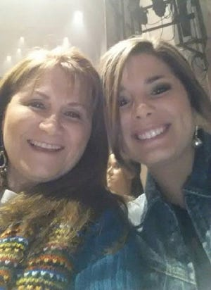 Vocal coach Valerie Andrus, left, poses for a picture with singer Kylie Frey of Opelousas at a Hunter Hayes concert.