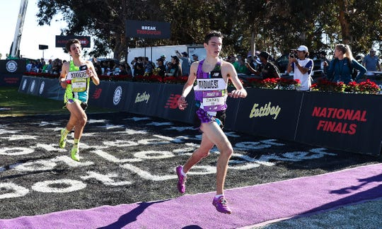 Zach Stewart of Brighton hits the finish line at the Foot Locker national cross country championship in San Diego on Saturday, Dec. 8, 2018.