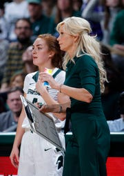 Michigan State coach Suzy Merchant, right, talks with Taryn McCutcheon during the second half of an NCAA college basketball game against Oregon, Sunday, Dec. 9, 2018, in East Lansing, Mich. Michigan State won 88-82. (AP Photo/Al Goldis)