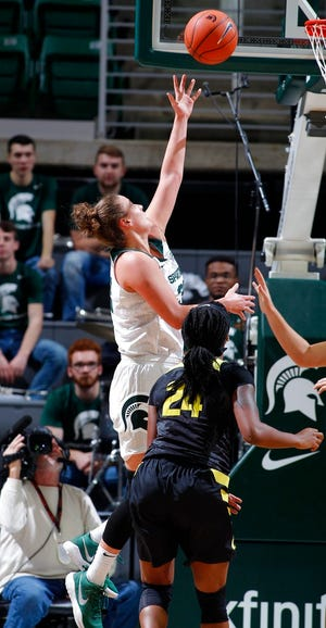Michigan State's Jenna Allen, left, shoots over Oregon's Ruthy Hebard (24) during the first half of an NCAA college basketball game, Sunday, Dec. 9, 2018, in East Lansing, Mich. Michigan State won 88-82. (AP Photo/Al Goldis)