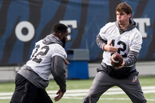 December 10 2018 - Brandon Silvers hands the ball off during the Memphis Express minicamp at Liberty Bowl Memorial Stadium on Monday. The Memphis Express' home opener is set for Feb. 16 versus the Arizona Hotshots at the Liberty Bowl Memorial Stadium.