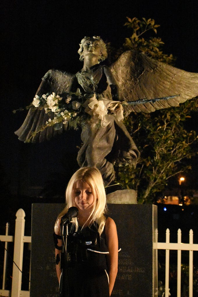 Sloan Wheeler sings a capella to open the service. The Marco Island Christmas Box Angel Memorial Service, commemorating children and grandchildren who have died, was held Thursday evening at Marco Island Cemetery.