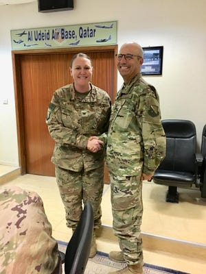 Philip Cunningham (right), a Delafield chaplain and captain in the Air Force, was deployed to Qatar earlier this year.