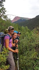 Chelsey Lewis (from front), Courtney Lamm and Erin Caughey backpack the Four Pass Loop in Colorado's Maroon Bells-Snowmass Wilderness.