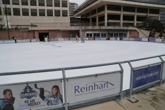 The Slice of Ice in Red Arrow Park ice rink is prepared by applying a special white ice paint that's applied on a thin layer of ice so that the sun doesn't melt the ice. The rink usually opens in mid-December.