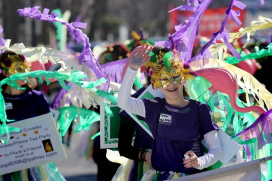 Girl Scouts from Troop 8098 stroll along Washington Avenue during the Cedarburg Winter Festival Parade.