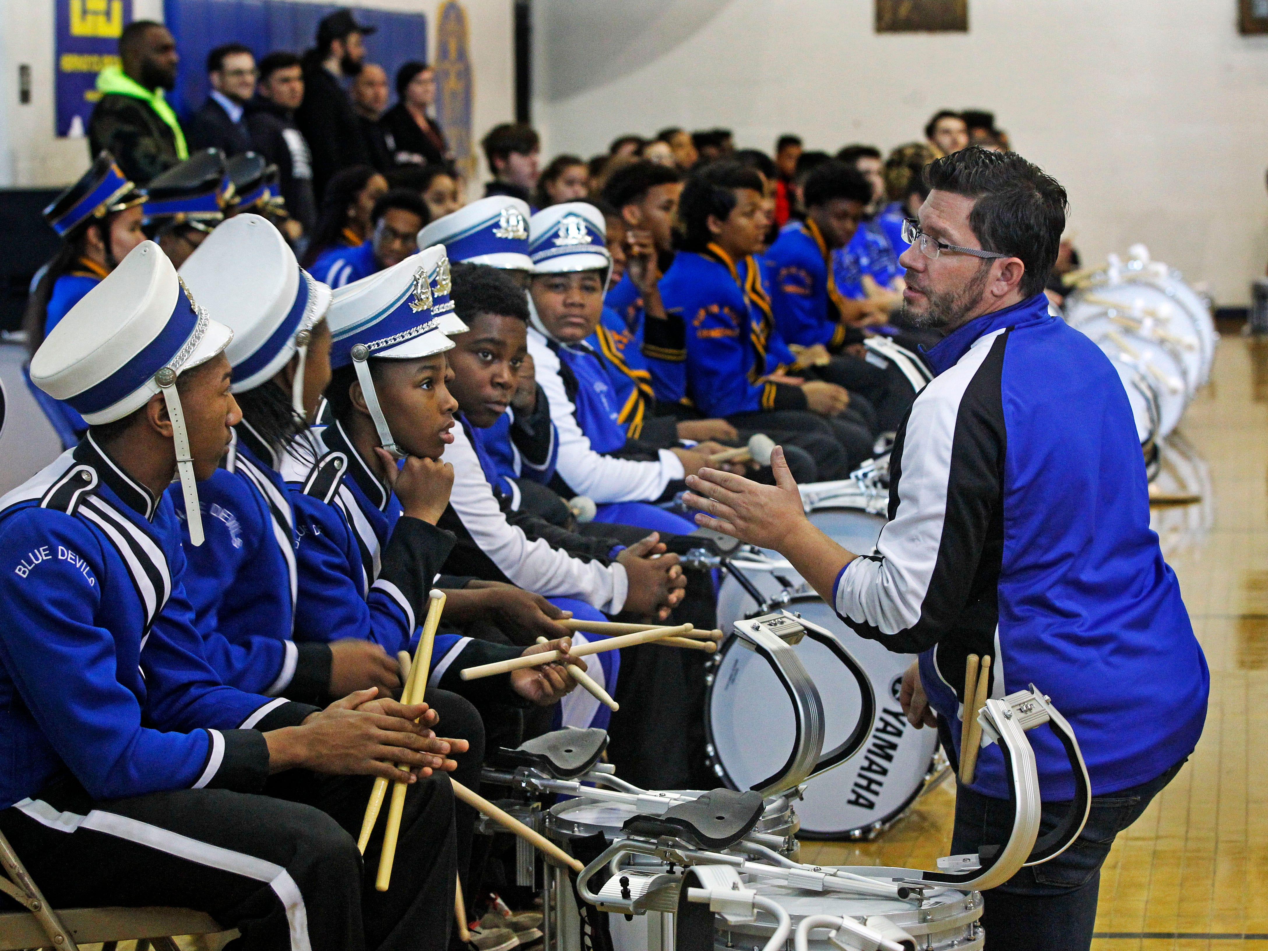 """Paul Braun, co-director of the North Division High School Drumline, left, talks with drumline members before the start of the MPS Hosts City Drumline Competition on Saturday, Dec. 8, 2018 at Rufus King High School. Maleak Taylor, left, listens with other students. """"Most freshmen come in and they act like freshmen. You don't see that from Maleak. He's a real leader and we (the drum line) will go as he goes. He's the leader,""""  said Braun."""