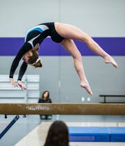 Waukesha junior Erin Wagner competes on the beam during the 2018 Cooney Gymnastics Invitational at Oconomowoc on Saturday, Dec. 8, 2018.