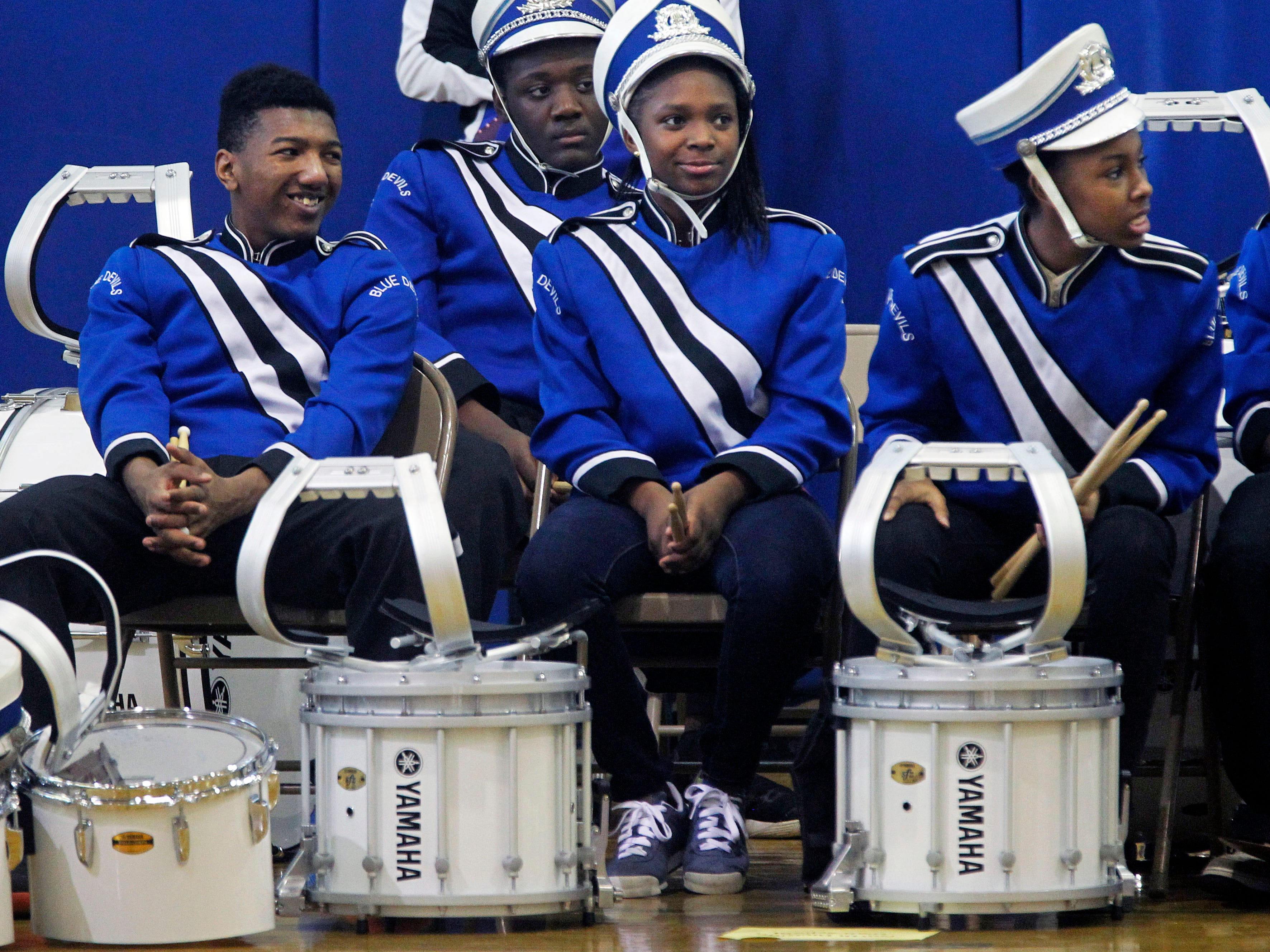 Maleak Taylor, a freshmen at North Divison High School, left, who plays quints for the drumline at Rufus King High School, watches band competition with other classmates, Aniya Taylor and Erica Wilborn, right,  at the MPS Hosts City Drumline Competition on Saturday, Dec. 8, 2018.