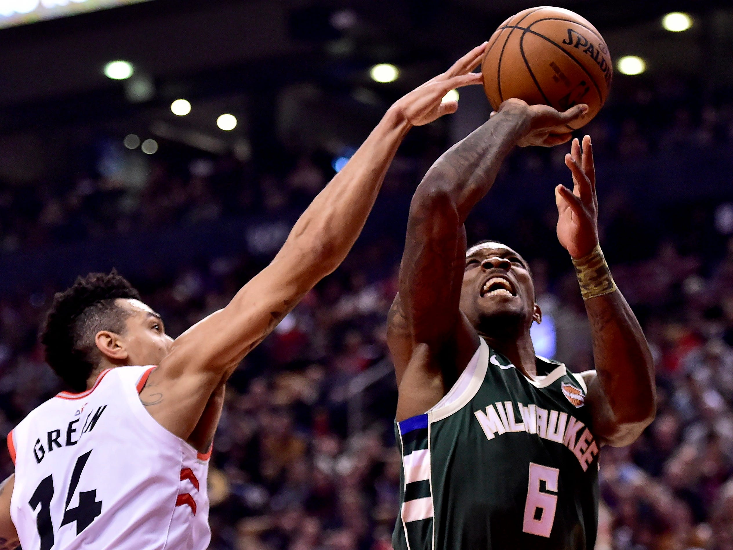 Milwaukee Bucks guard Eric Bledsoe (6) drives to the net as Toronto Raptors guard Danny Green (14) defends during first half NBA basketball action in Toronto on Sunday, Dec. 9, 2018. (Frank Gunn/The Canadian Press via AP)