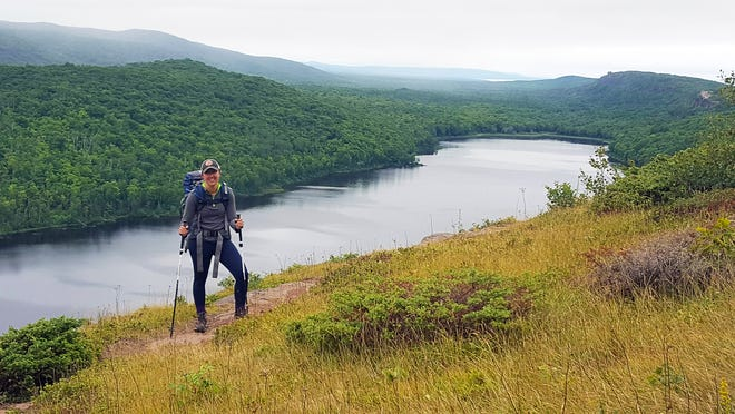 Chelsey Lewis stands along the Escarpment Trail above Lake of the Clouds in Michigan's Porcupine Mountains Wilderness State Park in August 2018.