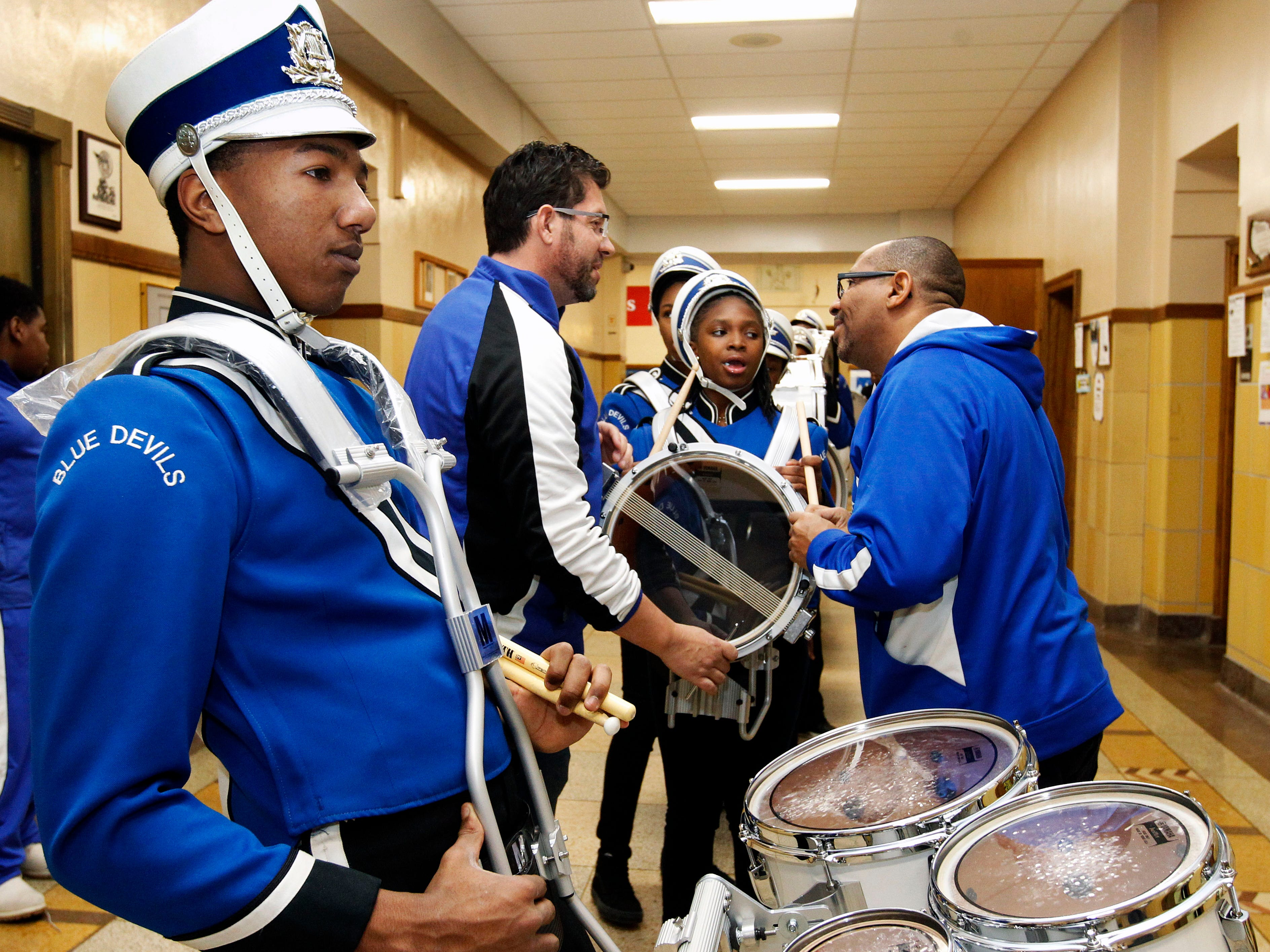 Maleak Taylor, a freshmen at North Divison High School, who plays quints for the drumline at Rufus King High School, waits for the band competition to begin at the MPS Hosts City Drumline Competition on Saturday, Dec. 8, 2018. In the background are co-directors of the North Division High School Drumline, left Paul Braun and Andre Torrence (cq).