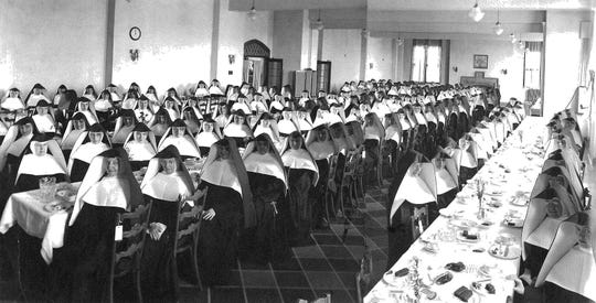 Caroline Hall at Mount Mary University has served many purposes during its 90 years, including as a dining hall for students and also for the School Sisters of Notre Dame at this 1941 graduation dinner. The fireplace on the north wall has been converted to gas and is expected to be used more often now.