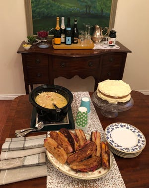 A Champagne bar, teamed up with chicken chili, Monte Cristo finger sandwiches and carrot cake makes a perfect spread for New Year's Day.