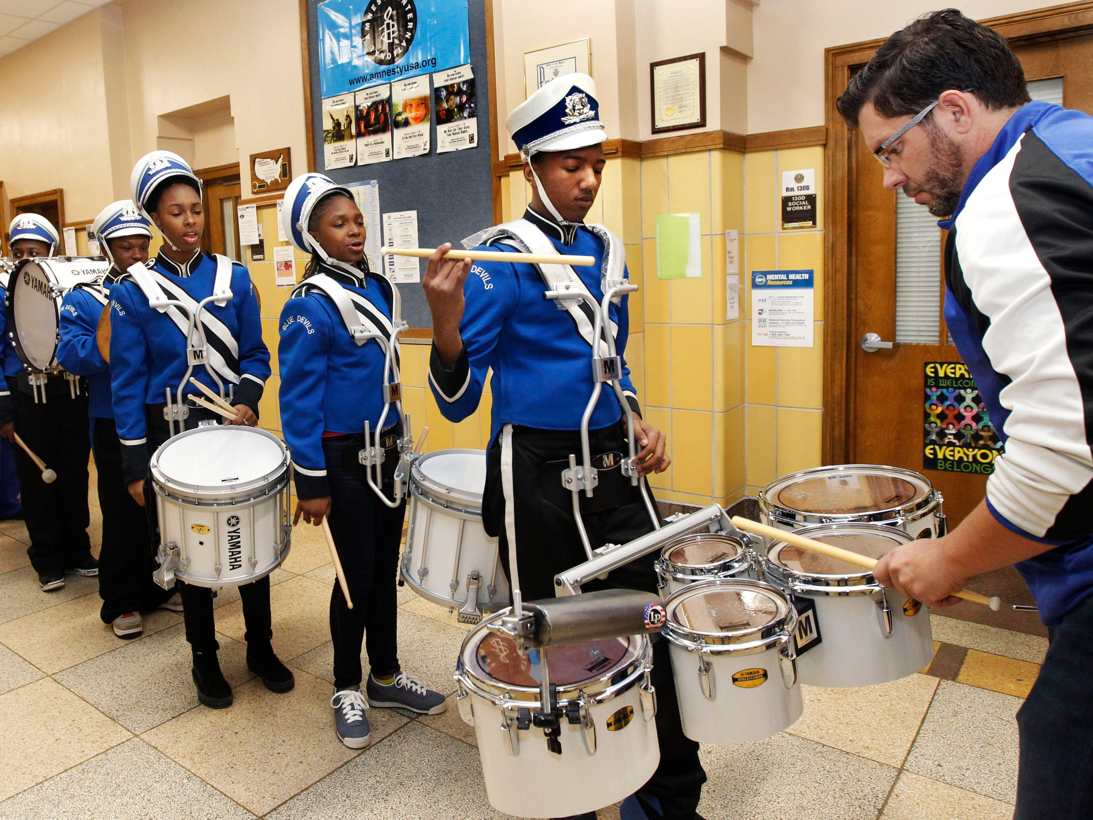 """Paul Braun, co-director of the North Division High School Drumline, right, checks Maleak Taylor's musical instruments, before the start of the MPS Hosts City Drumline Competition on Saturday, Dec. 8, 2018 at Rufus King High School. """"Most freshmen come in and they act like freshmen. You don't see that from Maleak. He's a real leader and we (the drum line) will go as he goes. He's the leader,"""" said Braun."""