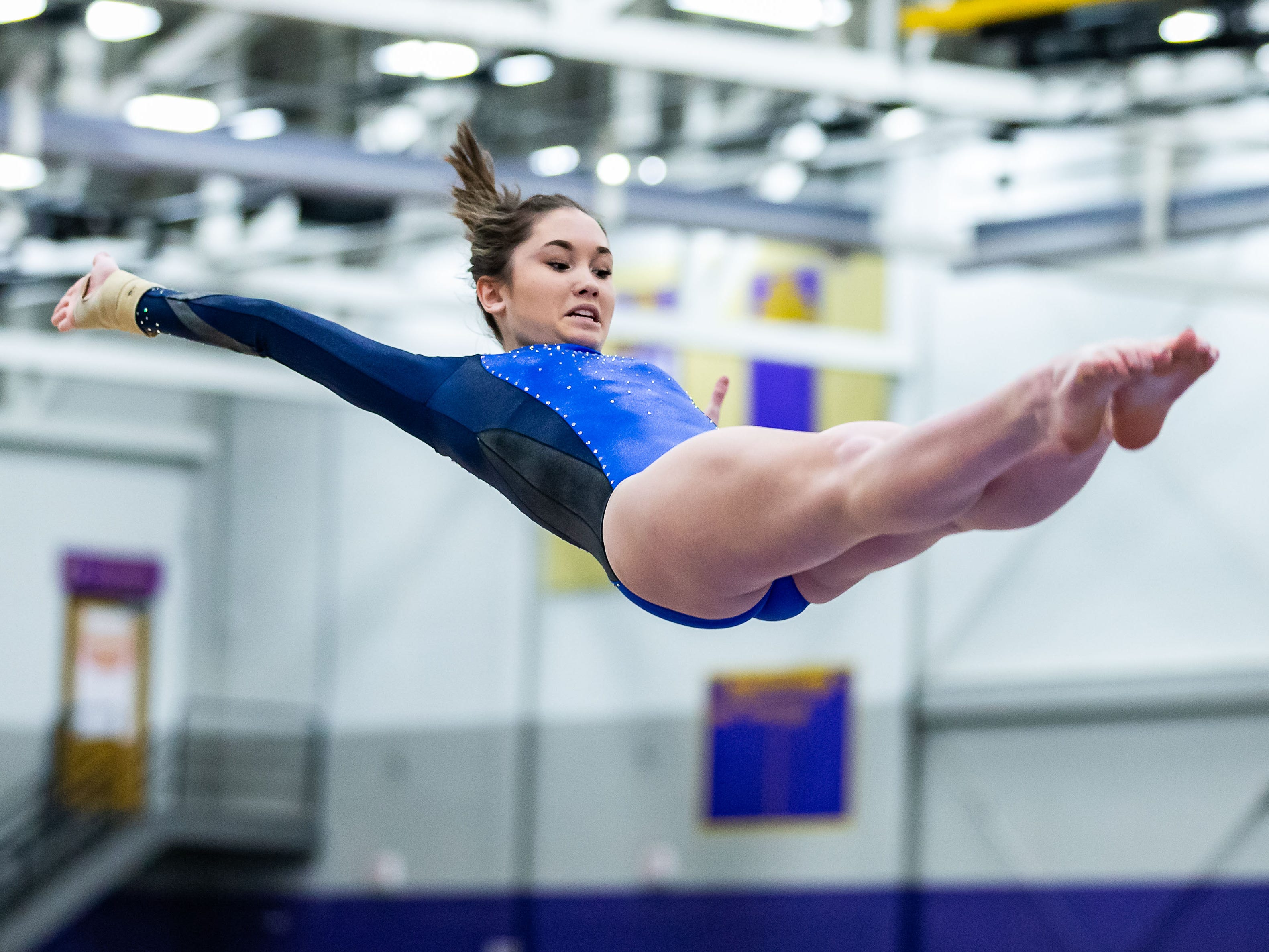 Brookfield junior Riley Feng launches off the vault during the 2018 Cooney Gymnastics Invitational at Oconomowoc on Saturday, Dec. 8.