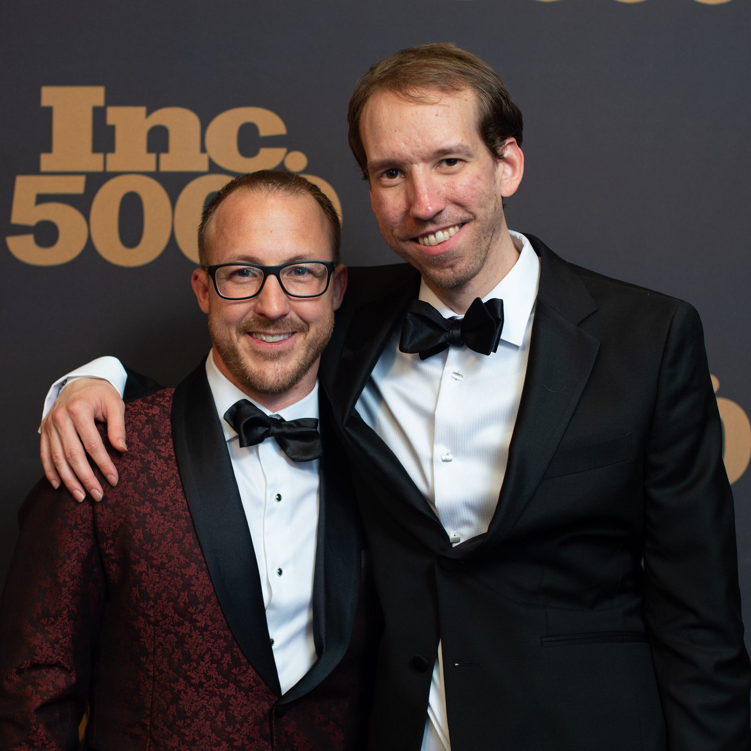 Brad Hollister (left) and Jason Swanson, co-founders of SwanLeap, attend the Inc. 5000 Awards. The magazine named SwanLeap the fastest growing company in the country.