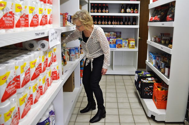 Lucy Weller stocks food pantry shelves at Family Sharing of Ozaukee County. Weller is the manager of the food pantry, which served 219 families in March.