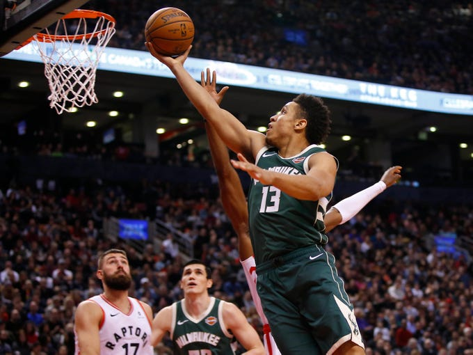 Dec 9, 2018; Toronto, Ontario, CAN; Milwaukee Bucks guard Malcolm Brogdon (13) goes up to make a basket against the Toronto Raptors at Scotiabank Arena. Milwaukee defeated Toronto. Mandatory Credit: John E. Sokolowski-USA TODAY Sports