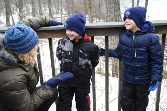 Levi Hammer, 5, center, and his brother Brady, 6, turn to their grandmother, Cheryl Kornburger and giggle at the Wehr Nature Center.