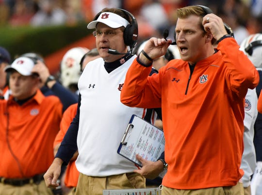 Auburn coach Gus Malzahn, left, and offensive coordinator Rhett Lashlee, right, during a game against Idaho on Nov. 21, 2015.