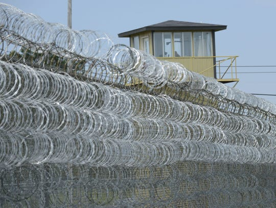 Concertina wire and a guard tower at Staton Correctional Facility seen during a tour through the facility in 2013.