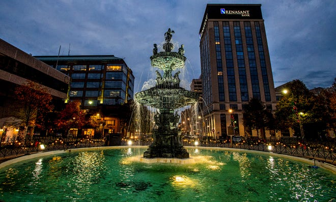 Cloudy skies are seen over the Court Square Fountain just after the sun sets in downtown Montgomery, Ala., on Friday November 30, 2018.