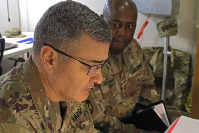 Brig. Gen. Clint Walker, commanding general of 184th Sustainment Command, has a discussion with Maj. Gen. Sylvester Cannon, assistant to the adjutant general for Alabama, December 3, 2018, at Fort Hood, Texas. Cannon is currently mentoring Walker for the 184th's upcoming deployment, a deployment Cannon returned from a few months ago. (U.S. National Guard photo by Sgt. Connie Jones)