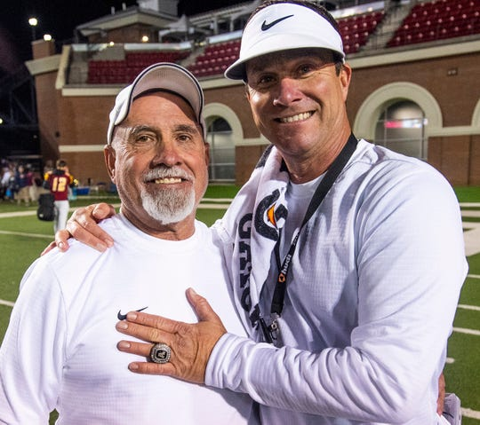 Autauga Academy assistant coach Bucky Mansmann with Autauga Academy head Coach Bobby Carr at the AISA Class AA State Championship game in Troy, Ala., on Friday November 16, 2018.