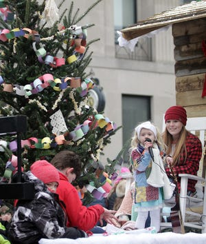 A little girl sings from the Smokey Mountain Christmas float at the Gallatin Christmas parade on Saturday, December 8, 2018.