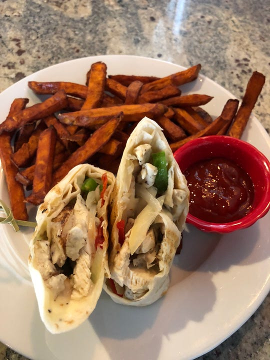 The Benchmark Philly Wrap is grilled chicken with peppers, onions, provolone cheese and spicy ranch rolled up in a wrap.