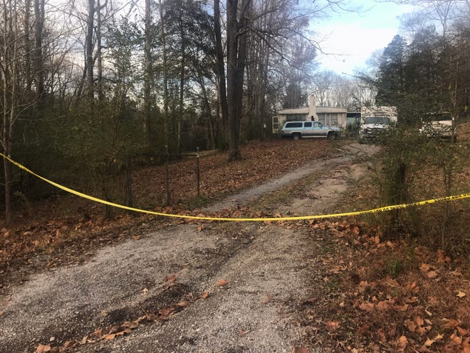 Law enforcement have blocked off the driveway of this property in Pegram, where officers are working the scene. A dog dragged partial human remains onto the porch of the neighboring home.