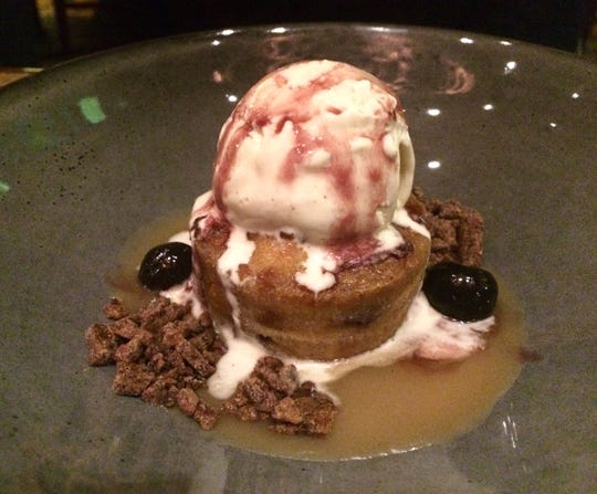 Bread pudding with black cherries, caramel, cocoa nibs and vanilla ice cream at Decker & Dyer.
