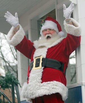 Santa Claus waves to the crowd at the Gallatin xmas parade on Saturday, December 8, 2018.