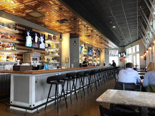 Benchmark Sports Pub + Eatery is centered around a long bar that spans most of the restaurant.