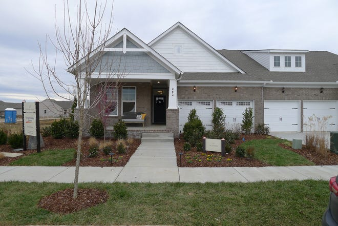David Weekley Homes' villas in Durham Farms are built in pairs with garages between them.