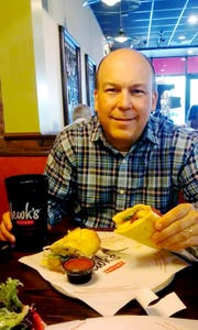 Clay Dyer enjoys a free lunch at Newk's during his birthday month.
