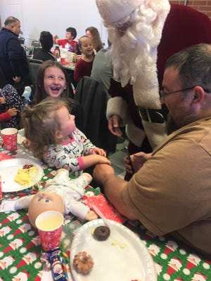 The Carson family, including Lea, age 2, Natalie, 6, and father Jim Carson, all from Etna, were among those who met Santa and Mrs. Claus at one of several Dec. 8 meals with Santa held at Nutcracker Family Restaurant.
