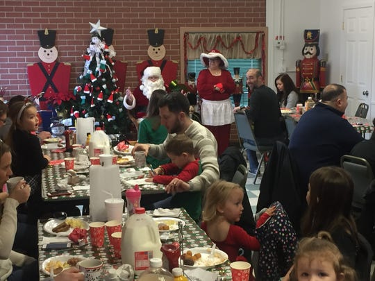 """Families finish dining as children prepare to chat with Santa and Mrs. Claus at the Nutcracker's Dec. 8 annual """"Breakfast with Santa."""""""