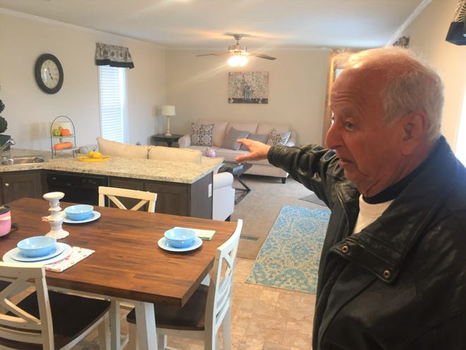 Ronald Thomas Sr. provides a tour of one of the numerous furnished modular home samples on display at Rona Homes headquarters, located at 12000 E. Broad Street in Pataskala.