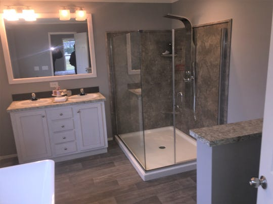 A master bath in one of deluxe modular home models to be found at Rona Homes.
