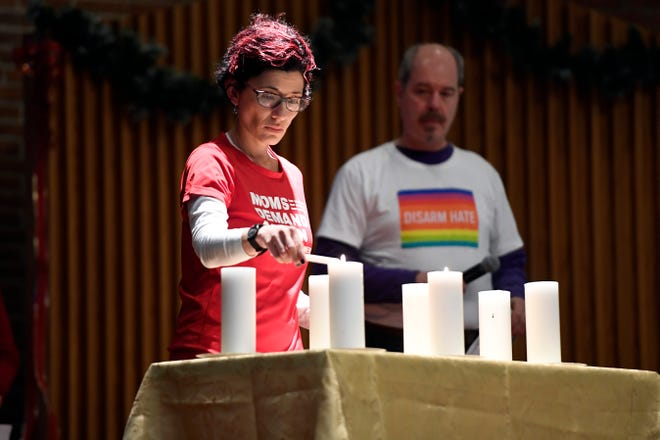 Larisa Mendez Downes, co-leader of the Bergen County chapter of Moms Demand Action, lights a candle for the students who died in the mass shooting at her alma mater, Marjory Stoneman Douglas High School in Parkland, FL.