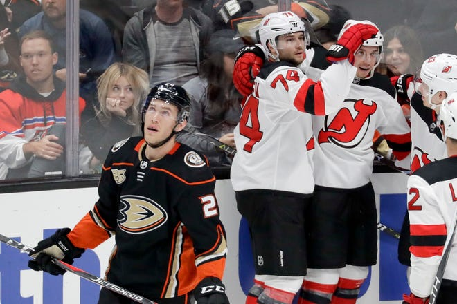 New Jersey Devils left wing Brett Seney, right, celebrates after scoring with defenseman Egor Yakovlev (74) during the second period of an NHL hockey game against the Anaheim Ducks in Anaheim, Calif., Sunday, Dec. 9, 2018.